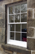 Lewis Decorating — Exterior sash and case window (Inverleith) — Window has been prepared and finished in high quality exterior gloss paint, the mastic was replaced providing the seal between the stonework and the window.